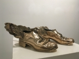 "<h5>Traveling Shoes</h5><p>Polished bronze, 4"" x 9""	x 11½"" (10.2 x 22.8 x 29.2cm)																																																																																																																																																																																																																																																																																																																																																																																																																																																																																																																																																																																																																			</p>"