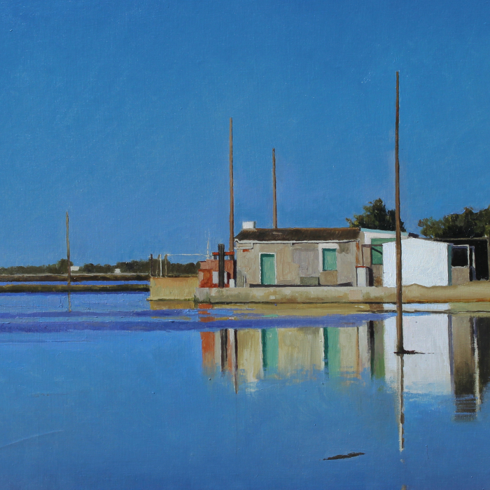 Oil on canvas painting of small, industrial structure at a marina's edge reflecting against the calm, blue water by Xavier Rodés titled Delta.