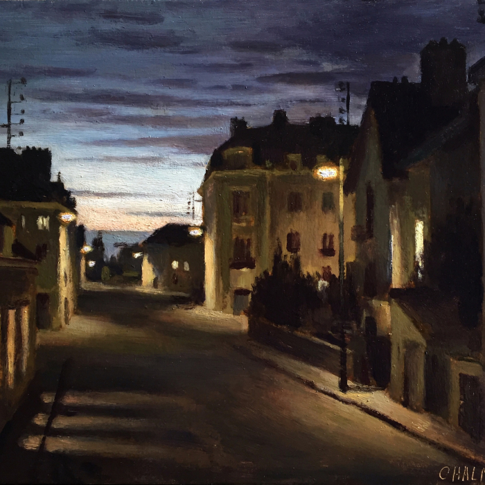 Oil on board painting of a street at dusk, both shadowed by buildings and glowing with light from their lit windows, by Marc Chalmé titled Nocturne.