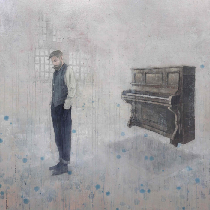 Acrylic on canvas painting of a young man with downcast eyes with an upright piano floating behind him against a faded background splattered with blue by Federico Infante titled The Pianist.