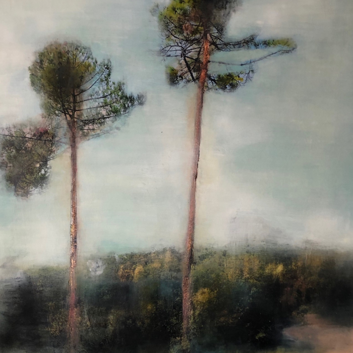 """Mixed media painting of two slightly blurred yet glowing trees with shrubs below against a blue sky by Sandrine Paumelle titled """"Un Belle Place."""