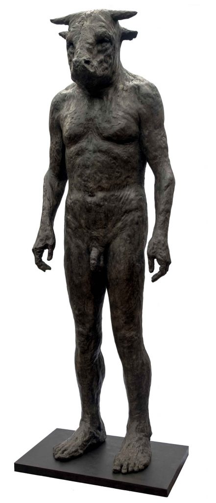 """Bronze sculpture of an enormous minotaur which somehow appears not ferocious at all but quite mild by Beth Carter titled """"Giant Standing Minotaur II."""""""