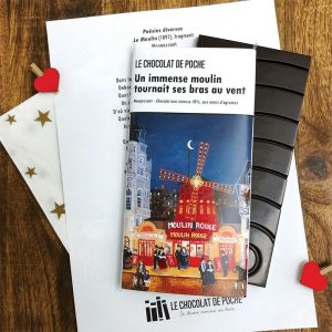 "Gourmet French chocolate made by the Le Chocolat de Poche company with a wrapper showing Hugo Galerie artist Fabienne Delacroix's painting ""Au Moulin Rouge."""