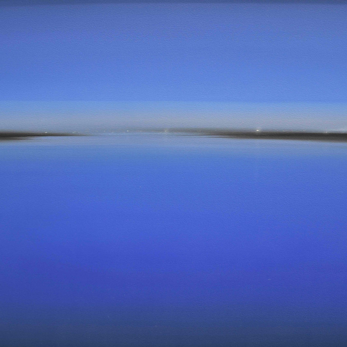 "Oil on board painting of a vivid, cobalt blue field of color that appears to be a landscape because of a distant horizon line by Diego Benéitez titled ""El Sonido del Color."""