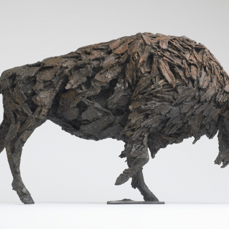 Bronze, textured sculpture of an imposing Buffalo charging forward titled Tatanka by Hugo Galerie artist Joseph Paxton.