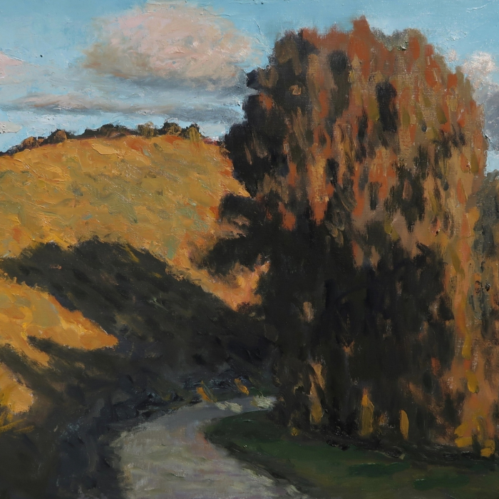 """Oil on canvas painting of a road winding beneath a hill and around a stand of lush trees in the evening light by Albert Hadjiganev titled """"Soir Dans les Collines II."""""""