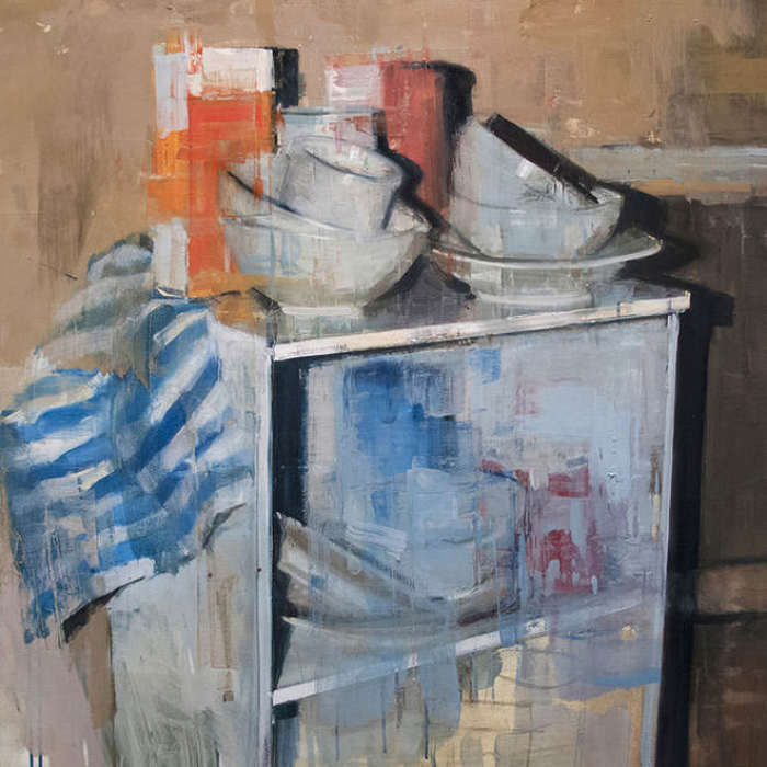 """Oil on canvas painting of a shelf piled high with white dishes, a blue striped cloth, and an orange carton by Joseph Adolphe titled """"Still Life no. 7."""""""