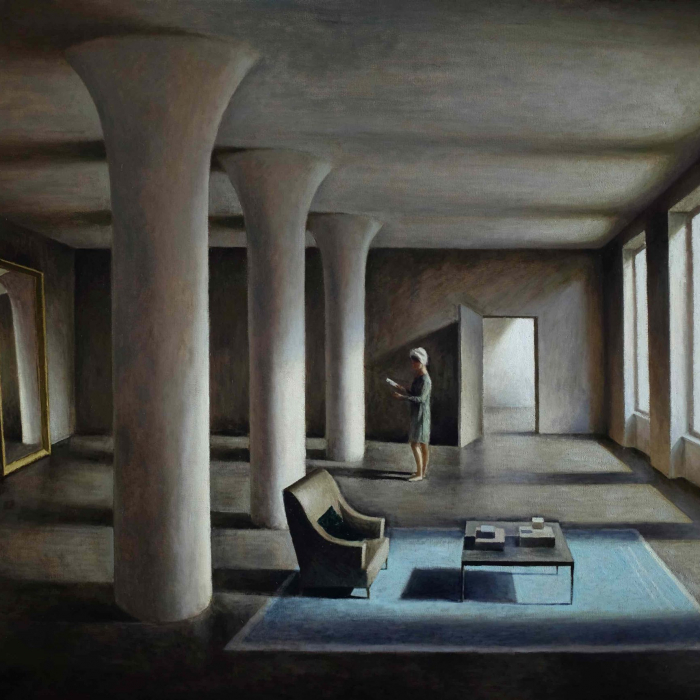 """Oil on canvas painting of a modern, stylized living room with three columns down the center and a woman standing in the sunlight from three windows as she reads by Marc Chalmé titled """"Les Colonnes."""""""