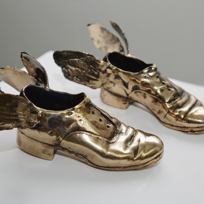 """Traveling shoes"", polished bronze, 4"" x 9"" x 11½"" (10.2x22.8x29.2cm)"